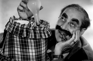 Groucho Marx holding a lightbulb for an advertisement circa 1955 © 1978 Paul Hesse - Image 820_103