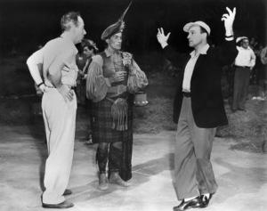 "Vincente Minnelli, Hugh Laing and Gene Kelly on the set of ""Brigadoon""1954 MGM** I.V. - Image 8705_0011"
