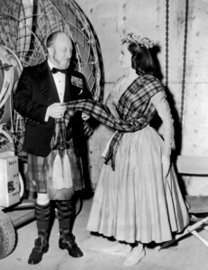 """Commander K.D. Iain Murray, technical advisor, and Cyd Charisse on the set of """"Brigadoon""""1954 MGM** I.V. - Image 8705_0014"""