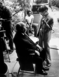 """""""Family Plot,""""Director Alfred Hitchcock with costume designer Edith Head on set.1976 Universal © 1978 Larry Barbier - Image 8897_0004"""