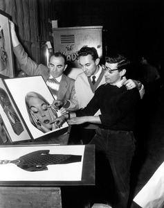 """""""Funny Face""""Production Manager Harry Caplan, Director Stanley Donen and Photographer Richard Avedon reviewing a photographic insert used in the main titles of """"Funny Face""""1956  Paramount - Image 9111_0367"""