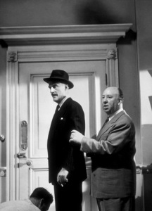 """""""Dial M For Murder,""""John Williams with Director Alfred Hitchcock.1954 Warner Bros. © 1978 Sanford Roth/AMPAS - Image 9138_0022"""