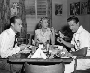 """Ray Milland, Grace Kelly, Robert Cummings behind the scenes of """"Dial M For Murder"""" taking their lunch break.1954Photo by Pat Clark  - Image 9138_0041"""