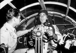 """Chain Lightning"" Humphrey Bogart receiving flying instructions from Col. J. Bradley1950 Warner Bros.MPTV - Image 9211_0001"
