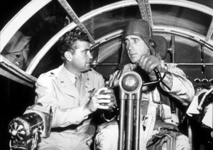"""Chain Lightning"" Humphrey Bogart receiving flying instructions from Col. J. Bradley1950 Warner Bros.MPTV - Image 9211_0002"