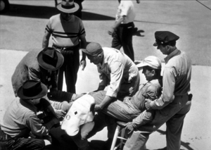 """""""Chain Lightning"""" Humphrey Bogart with crew helping him into pilot suit1950 Warner Bros.Photo by F. BjerringMPTV - Image 9211_0003"""