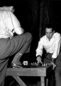"""The Enforcer""Humphrey BogartBackstage between takes1950 Warner Bros.Photo by Mac JulianMPTV - Image 9214_0002"