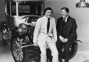 """The Mike Douglas Show"" Mike Douglas and Rudy Vallee relaxing on the bumper of an old time Pierce Arrow1974 - Image 9251_0001"