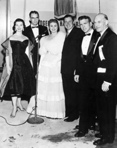 """Miss Oklahoma, Clarence Burch (executive assistant to the Governor of Oklahoma), Shirley Jones, Will Rogers Jr., Oklahoma State Senator George Nye and Dick Dickson (United Artists Theatre Circuit, Inc., executive) at the Hollywood premiere of """"Oklahoma!"""" at the Egyptian Theatre 11-17-1955** B.D.M. - Image 9577_0004"""