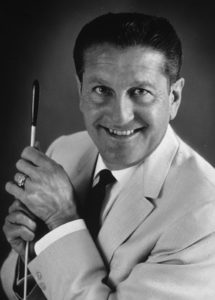Lawrence Welk holding a conductor
