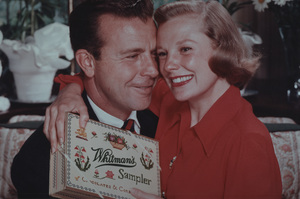 June Allyson and Dick Powell posing for a Whitman