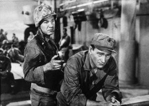 """Sands of Iwo Jima""Forrest Tucker and John Wayne. © 1949 Republic - Image 9905_0002"