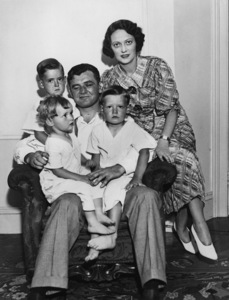 """Boxers / Boxing""Jimmy Braddock, newly crowned heavyweight champ, and his family.  It was for them he climbed into the ring and seriously socked the clownishness and championship out of Max Baer.  This picture was made at his home in Guttenberg, New Jersey.  (left to right) Rose Marie, 2; Howard, 3; Jim Jr., 4, and the champ and his wife, Mae / June 14, 1935 - Image 9919_0037"