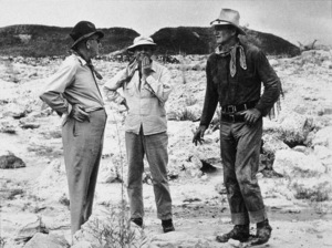 """Hondo""John Ford, director John Farrow, John Wayne1953 Warner Bros.© 1978 Bud Fraker - Image 9960_0013"