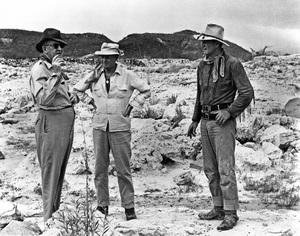 """Hondo""John Ford, director John Farrow, John Wayne1953 Warner Brothers © 1978 Bud Fraker - Image 9960_0015"