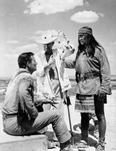"""Hondo""John Wayne, director John Farrow, Rodolfo Acosta1953© 1978 Bud Fraker - Image 9960_0033"