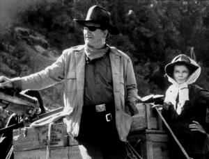 """Rooster Cogburn,"" Universal 1974.John Wayne and Katharine Hepburn. © 1978 David Sutton - Image 9967_0029"