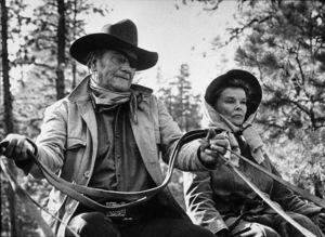 """Rooster Cogburn,"" Universal 1974.John Wayne and Katharine Hepburn. © 1978 David Sutton - Image 9967_0031"