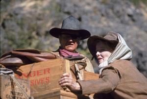 """Rooster Cogburn,"" Universal 1974.John Wayne and Katharine Hepburn. © 1978 David Sutton - Image 9967_0038"