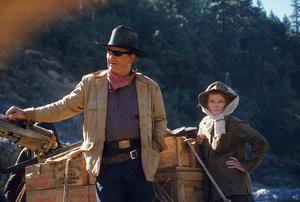 """Rooster Cogburn,"" Universal 1974.John Wayne and Katharine Hepburn. © 1978 David Sutton - Image 9967_0061"