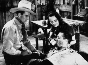 """Pals of the Saddle,"" Republic 1938.John Wayne and Doreen McKay. - Image 9984_0001"