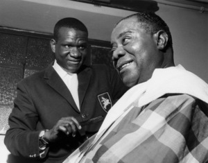 Louis Armstrong having his haircut in Hammersmith, London 1962Photo by Brian Foskett © National Jazz Archive - Image FOS_0007