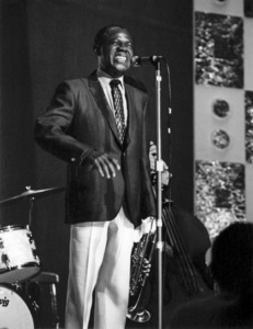 Louis Armstrong on stage, Hammersmith Odeon, London 1968 Photo by Brian Foskett © National Jazz Archive - Image FOS_0018